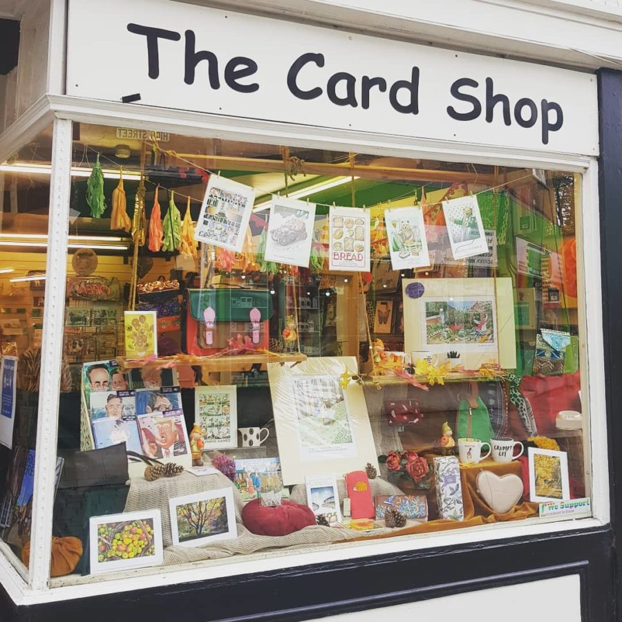 Best Wishes window display with sign saying The Card Shop and greetings cards in window