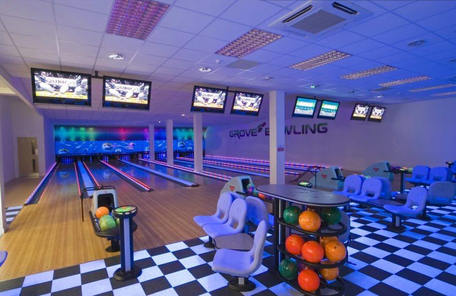 Bowling alley showing screens and balls and chequered floor