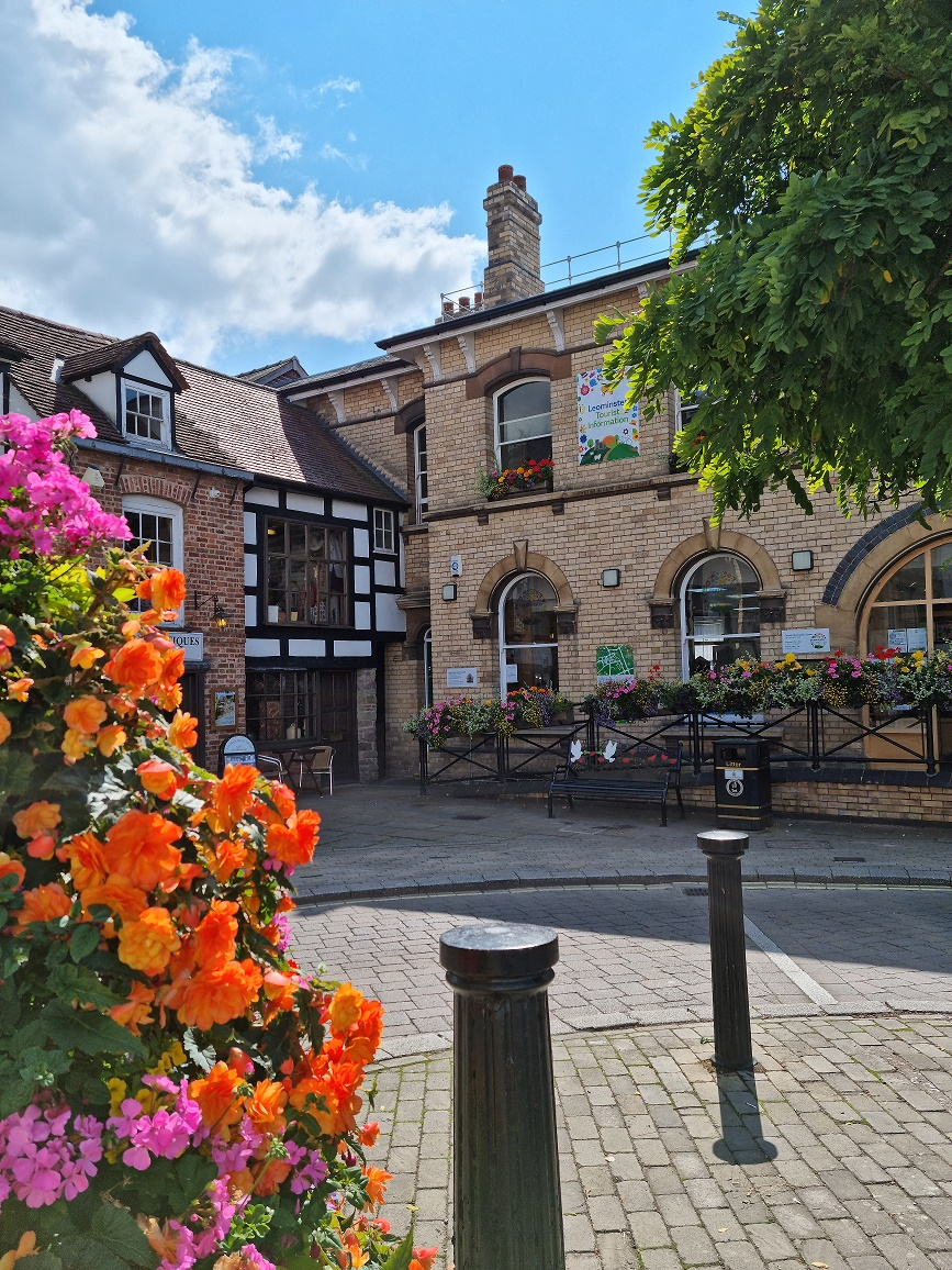 Corner Of Corn Square with Tourist Info Centre and Floral display
