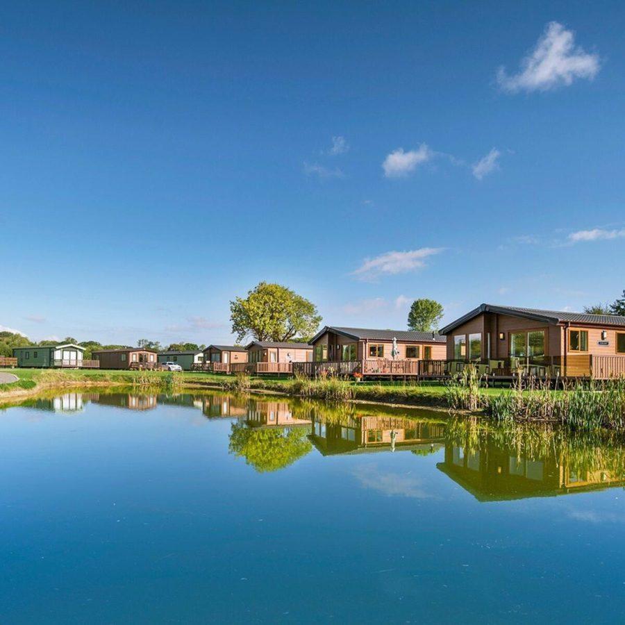 Lake And Lodges reflecting blue skies