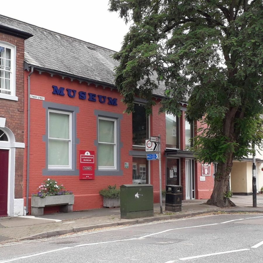 Front of Leominster Museum with red brick building and large windows