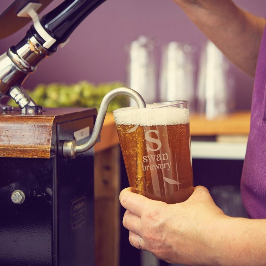 Pint Of Swan Brewery Beer being pulled from pump