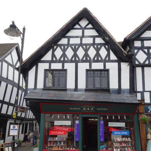Exterior of framing gallery showing timber framed building and shoe shop underneath