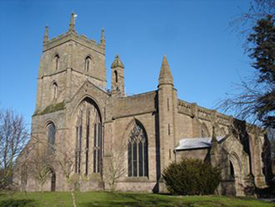 Leominster Priory Church external image showing church with tower and large stained glass windows