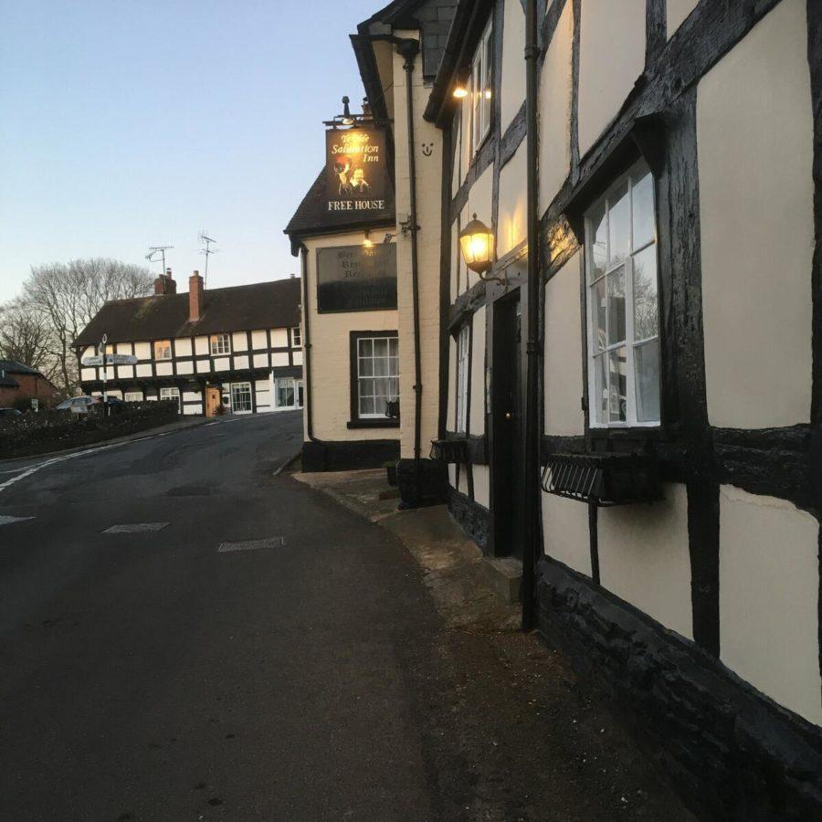 Outside of ye olde salutation showing timber framed buildings and pub sign