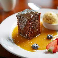Sticky Toffee Pudding with icecream and syrup
