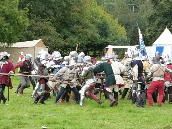 Mortimer Battle with men in silver suits of armour with flags and swords