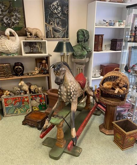 Wooden white Rocking Horse with antique toys in background